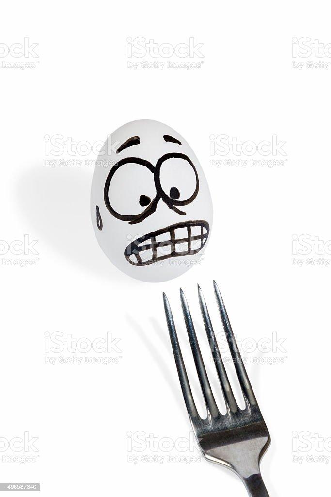 Egg scared fork stock photo