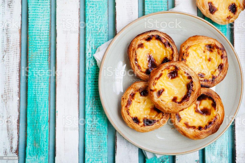 Egg tart. Portuguese dessert. Wooden background. stock photo