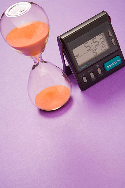 Egg Timer and Digital Clock stock photo
