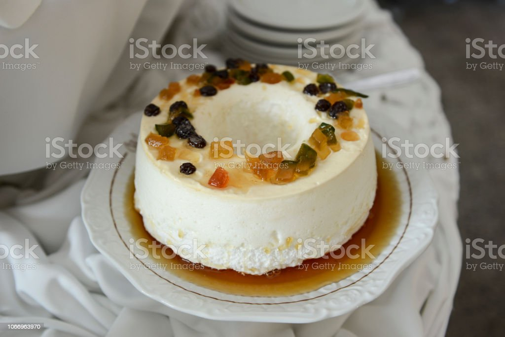 Egg White Pudding With Sugar Syrup And Dried Fruit On An Ornate