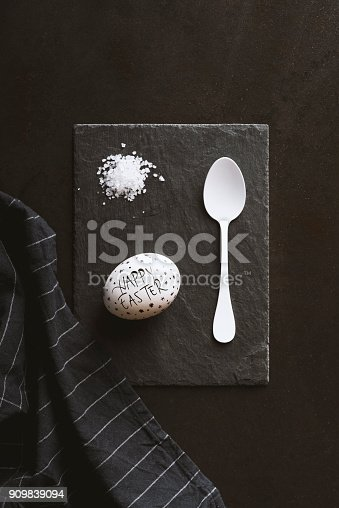 Hard boiled egg and crystal salt with a spoon on plate