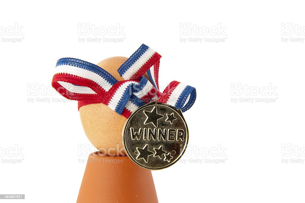 Egg with winner medal and ribbon stock photo