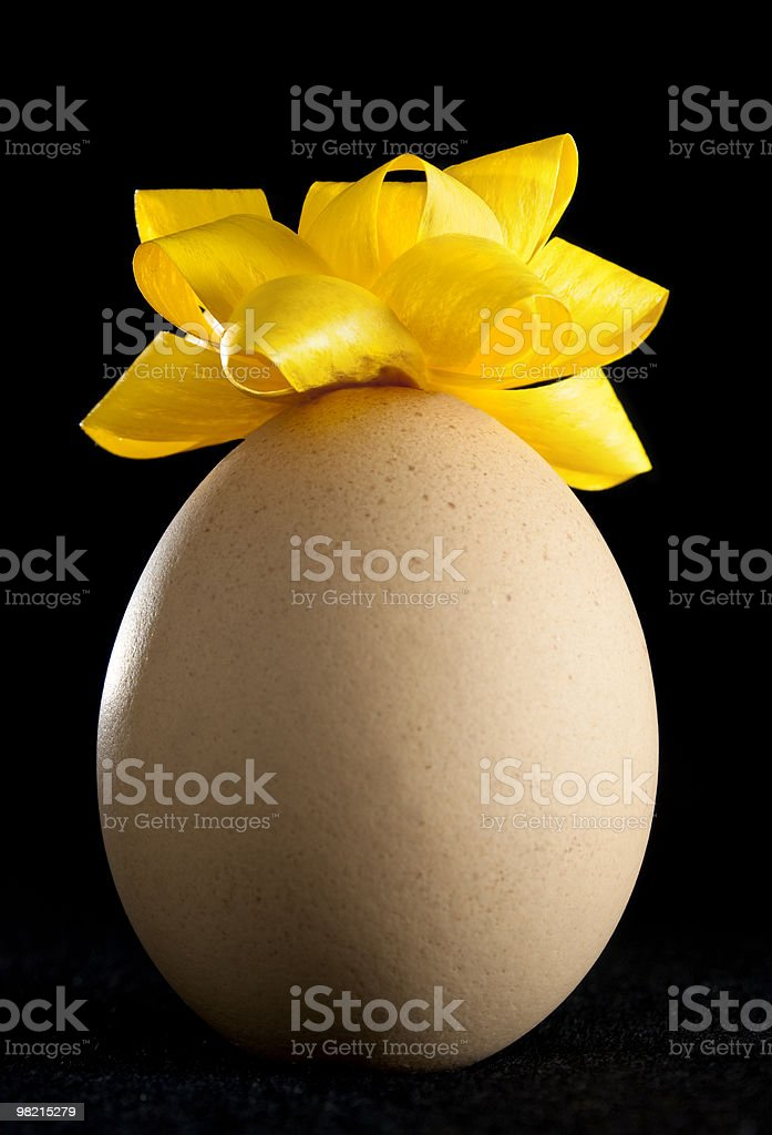 Egg with Yellow Rosette royalty-free stock photo