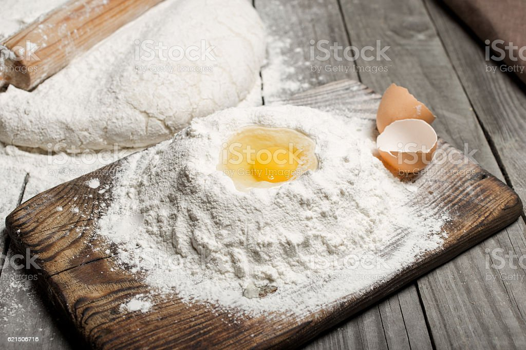 Egg yolk in the flour on wooden table in bakery foto stock royalty-free