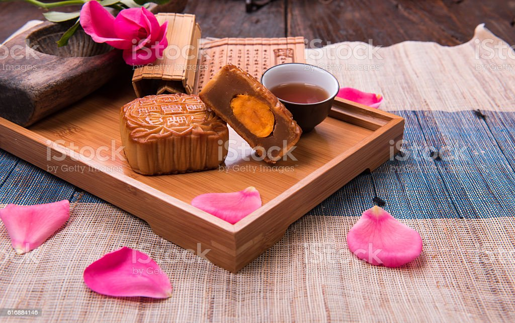 Egg yolk moon cake in bamboo tray. stock photo