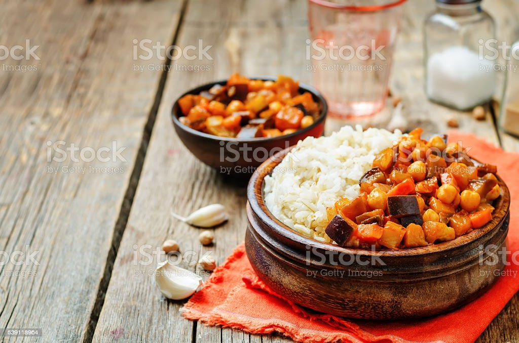 Eggplant and tomato chickpea curry with rice stock photo