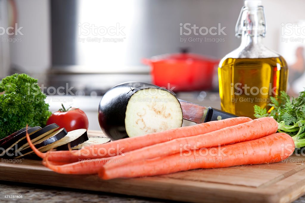 Eggplant and Veggies on Cutting Board royalty-free stock photo