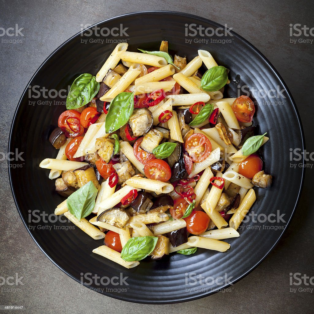 Eggplant Chilli and Tomato Pasta stock photo