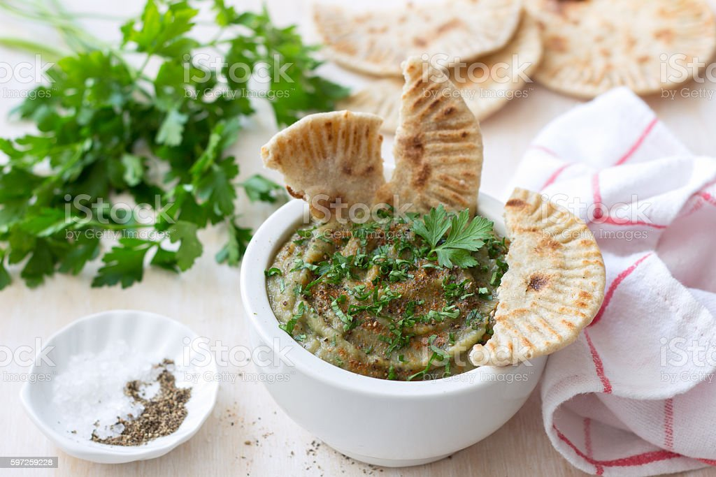 Eggplant dip with parsley and whole grain flat bread stock photo
