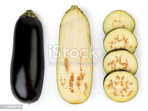 Eggplant isolated on white background. Eggplant, halved eggplant, aubergine ring top view. Close up.
