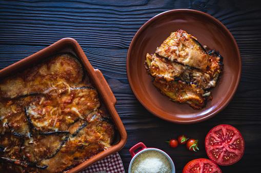 Eggplant parmesan vegan recipe also Aubergine Parmigiana italian vegetarian recipe with parmesan cheese and ingredients