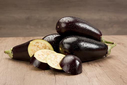 Fresh eggplants on wood table.