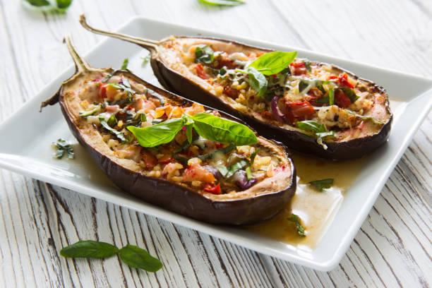 Eggplants stuffed with bulgur and vegetables stock photo