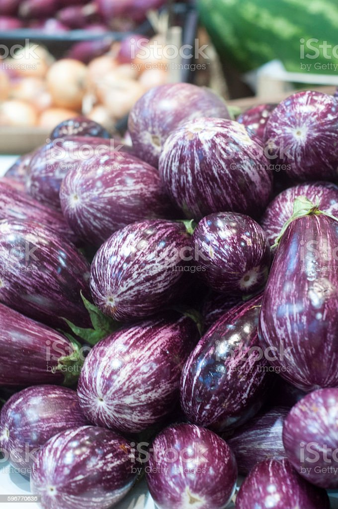 Eggplants with stripes at the market stock photo