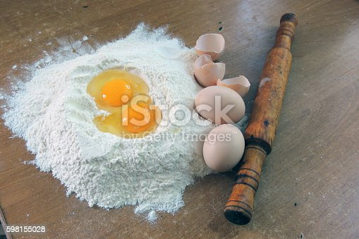 Eggs, rolling pin and flour closeup