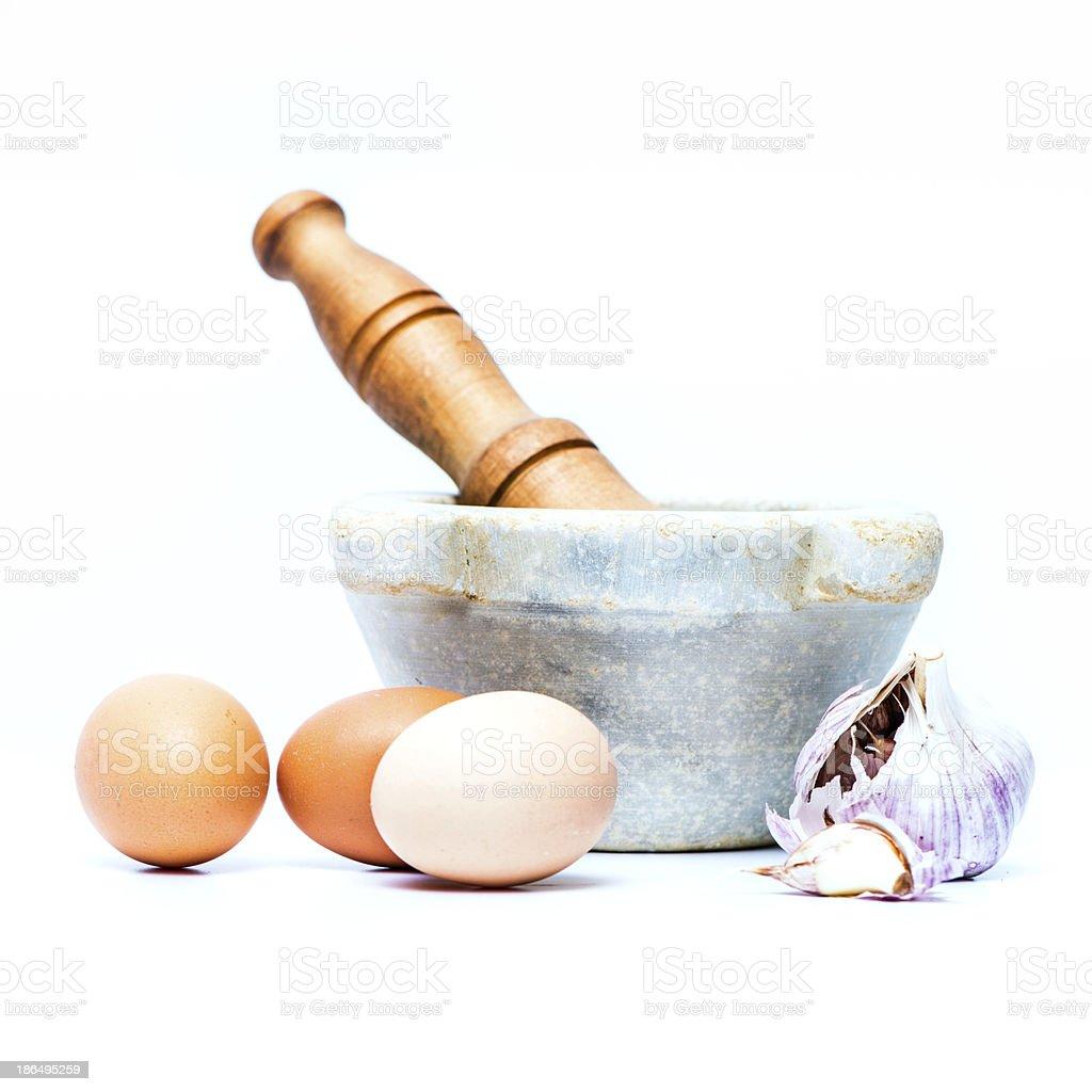 Eggs and garlic by mortar royalty-free stock photo
