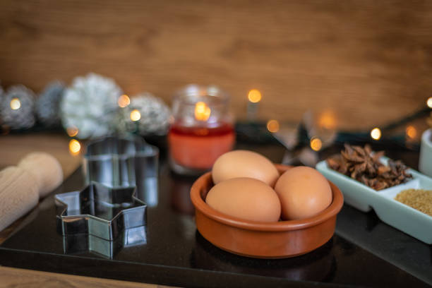 eggs and ingredients for baking at christmas - christmas stock photos and pictures