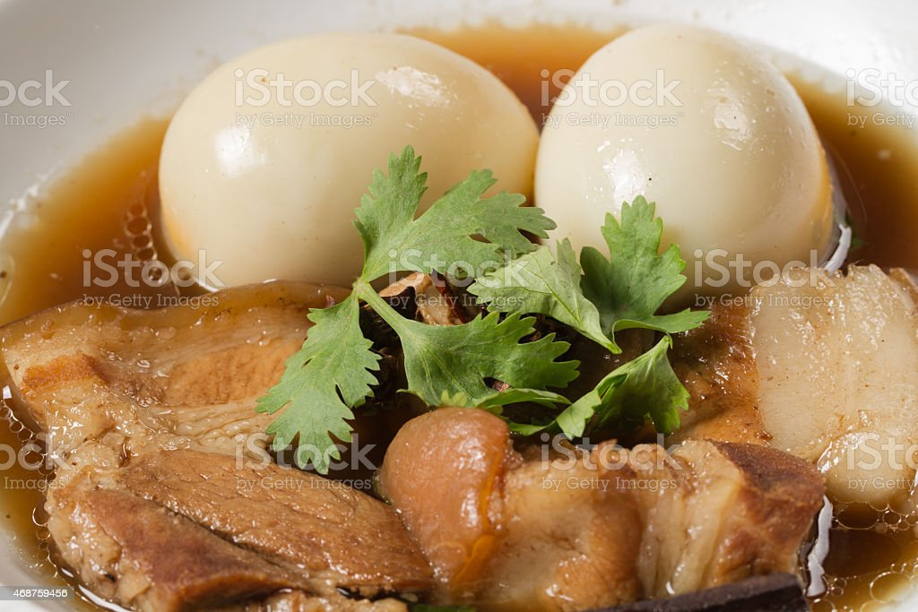 eggs and pork in brown sauce stock photo