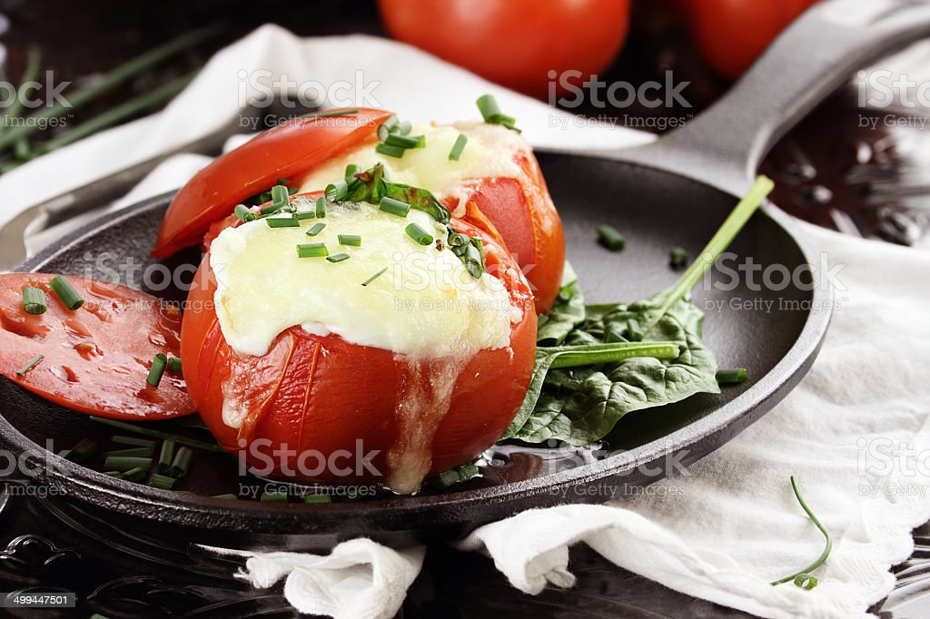 Eggs Baked in Tomato stock photo