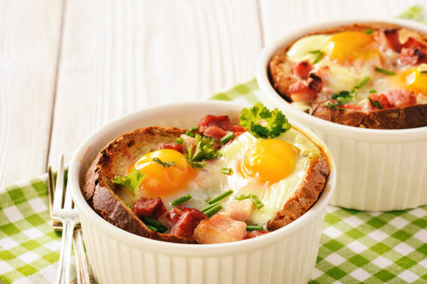 Eggs baked with bacon, tomatoes, garlic and bread. stock photo