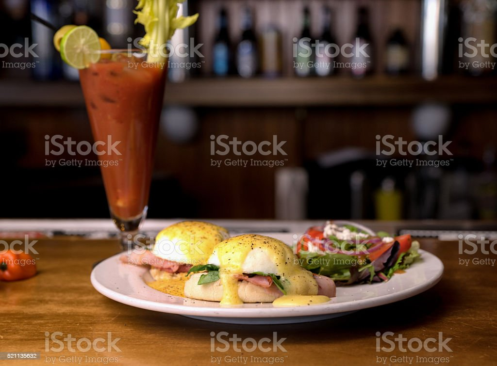 Eggs Benedict and Bloody Mary stock photo