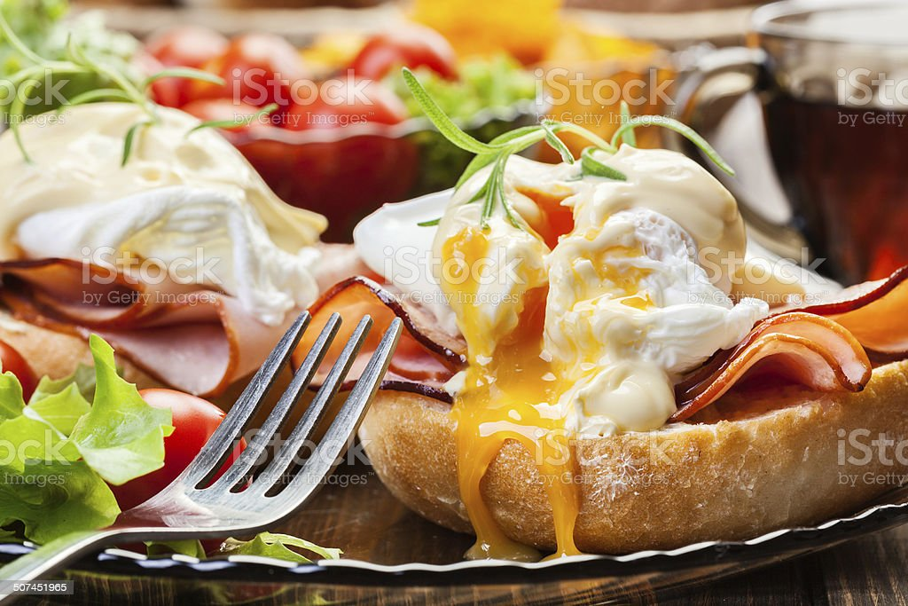 Eggs Benedict on toasted muffins with ham - Royalty-free Bread Stock Photo