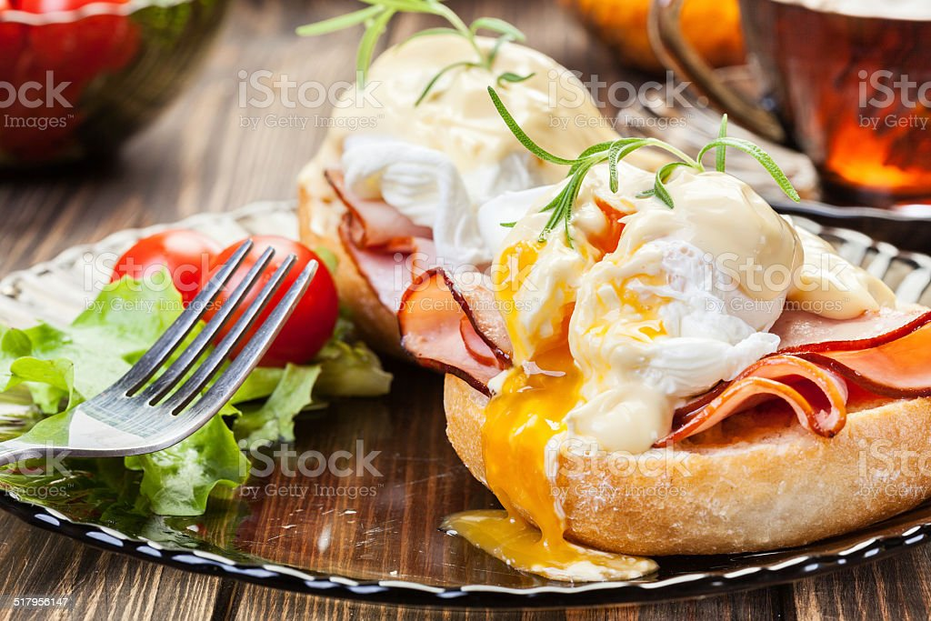 Eggs Benedict on toasted muffins with ham stock photo