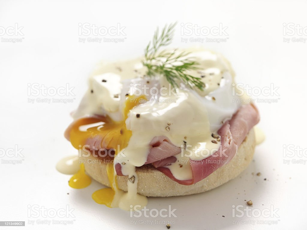Eggs Benedict with a green accent on a white background stock photo