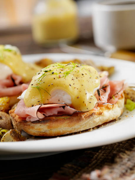 Eggs Benedict with Black Forest Ham and Hash Browns stock photo