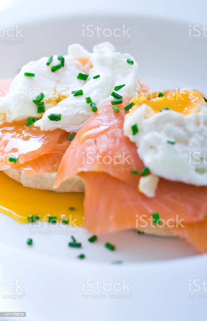 Eggs benedict with salmon and chives (macro) royalty-free stock photo