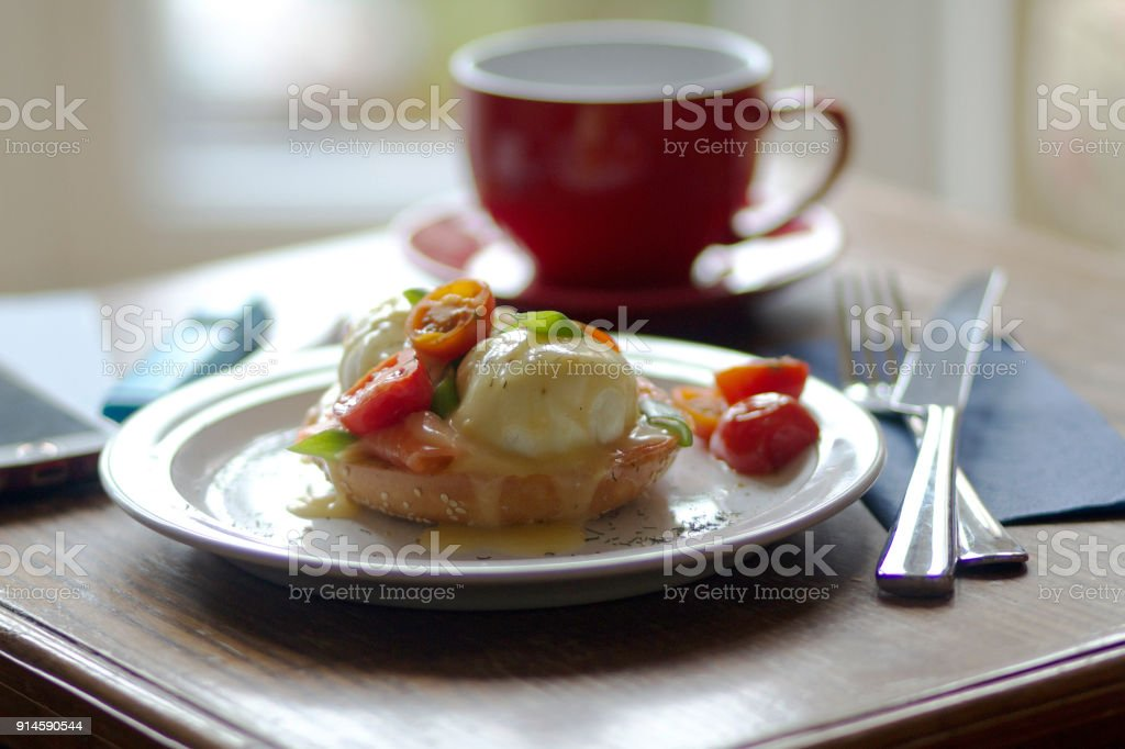 Eggs Benedict with Smoked Salmon and Tomatoes stock photo