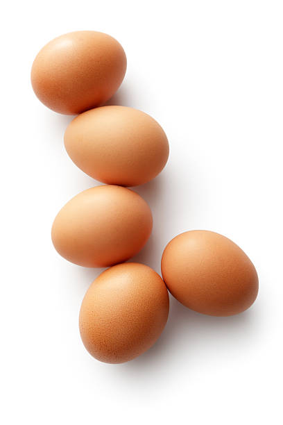 Eggs: Brown Eggs Isolated on White Background stock photo