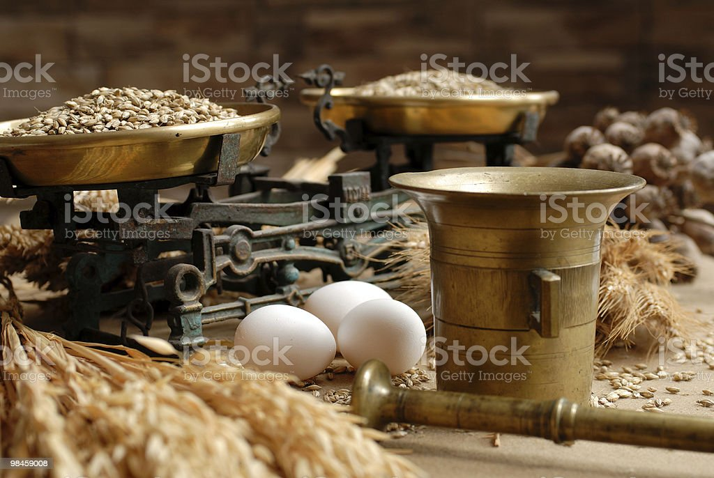 Eggs, corn and household scales royalty-free stock photo