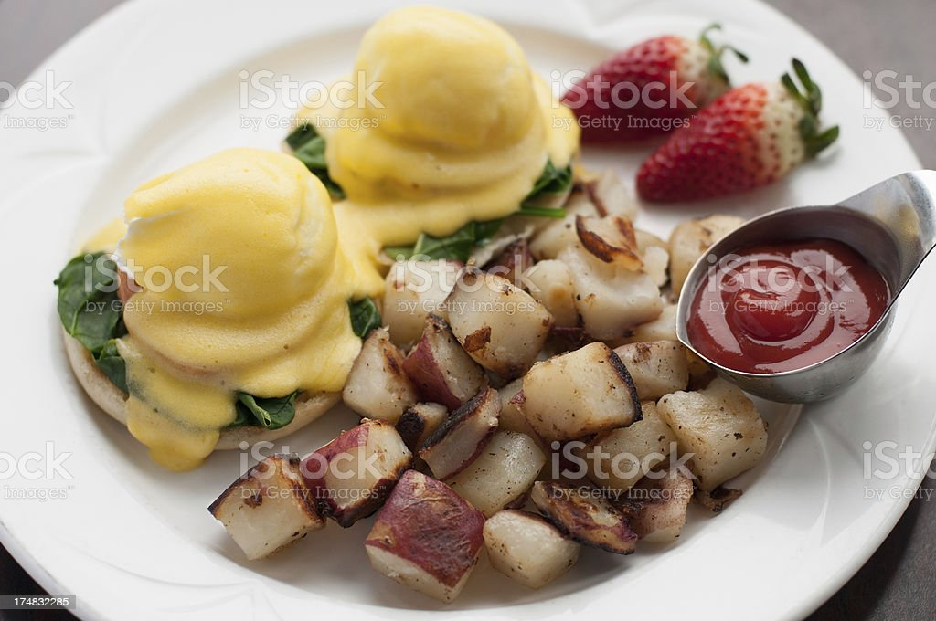 Eggs Florentine with Hash Brown Potatoes royalty-free stock photo