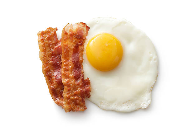 eggs: fried egg and bacon isolated on white background - egg stock photos and pictures