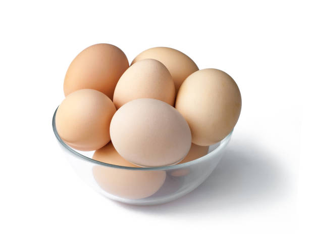 Eggs in a bowl isolated on white background stock photo