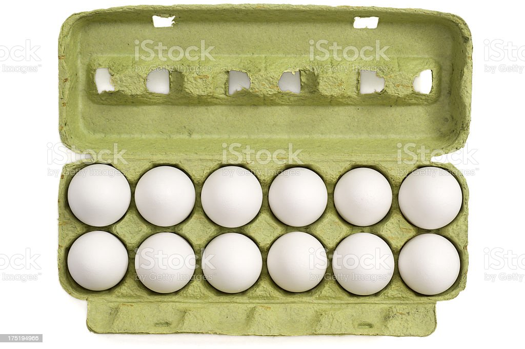 Eggs in a carton on white background royalty-free stock photo