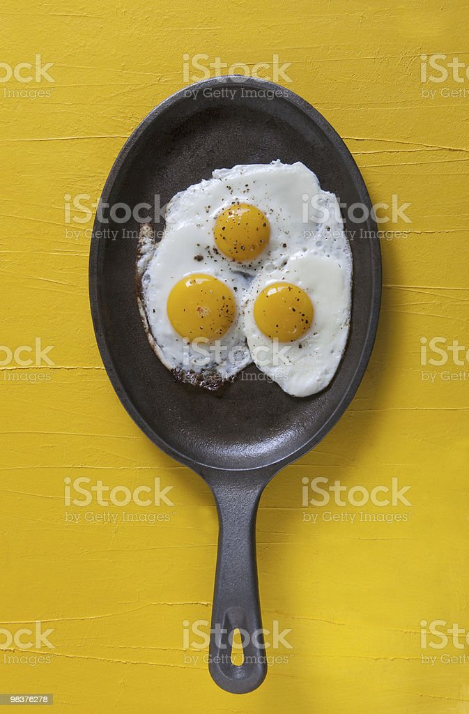 eggs in a pan royalty-free stock photo