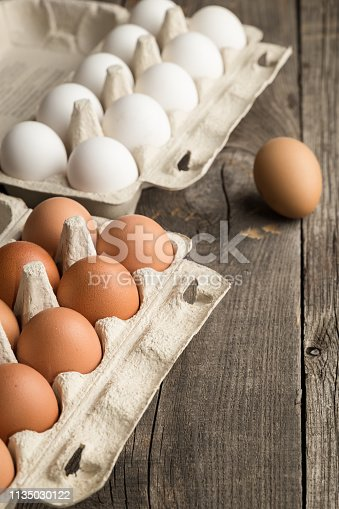 Eggs in box container on a wooden table