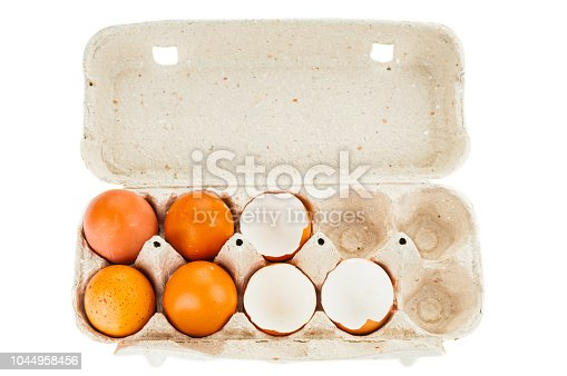 Eggs in carton tray on white background