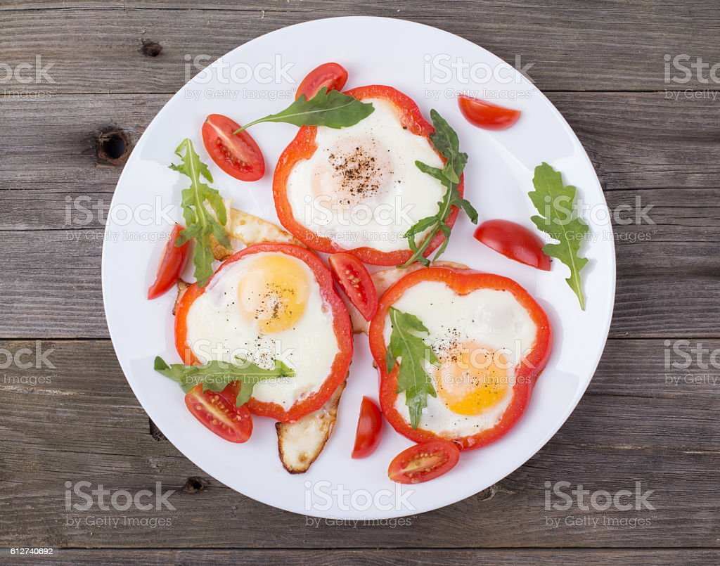 Eggs in pepper on a plate on a table stock photo