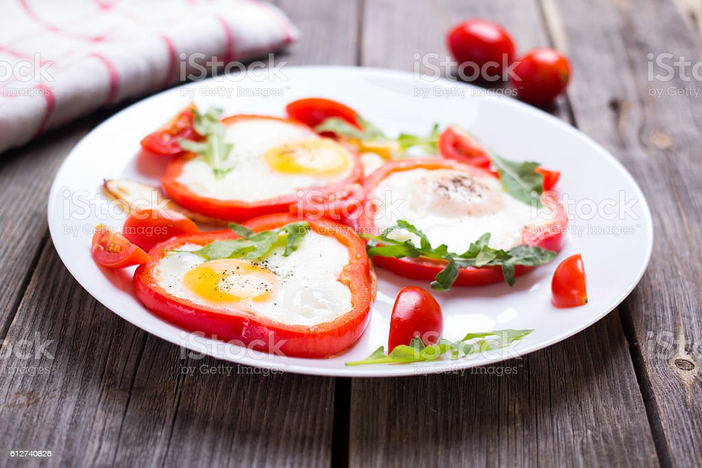 Eggs in pepper on a plate stock photo