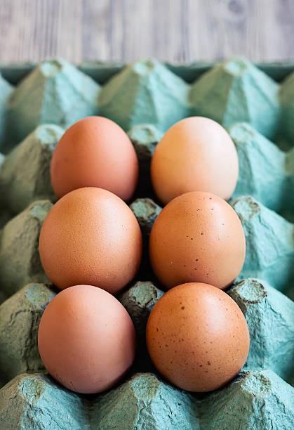 Eggs in rustic paper box stock photo