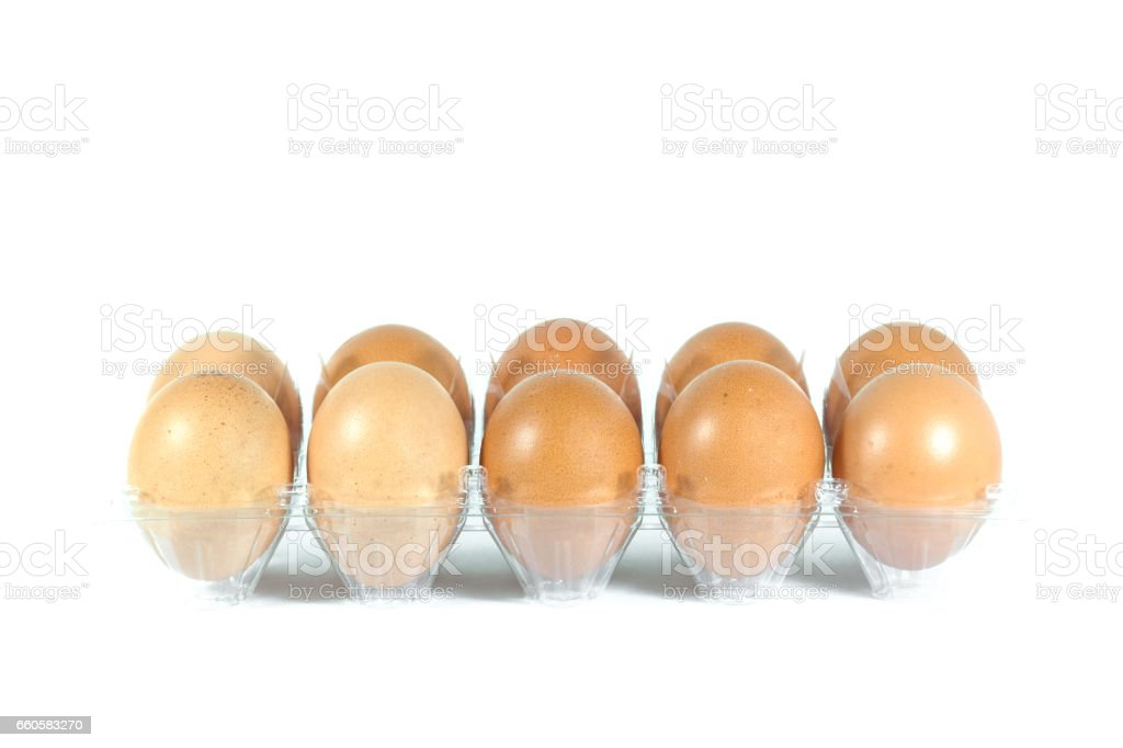 Eggs in the plastic panel on white background royalty-free stock photo
