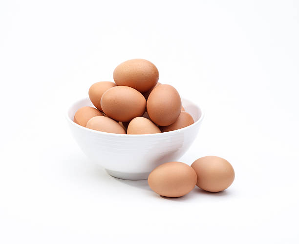 Eggs in white bowl a healthy food for gift isolated stock photo