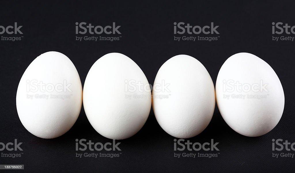 Eggs isolated on black background stock photo