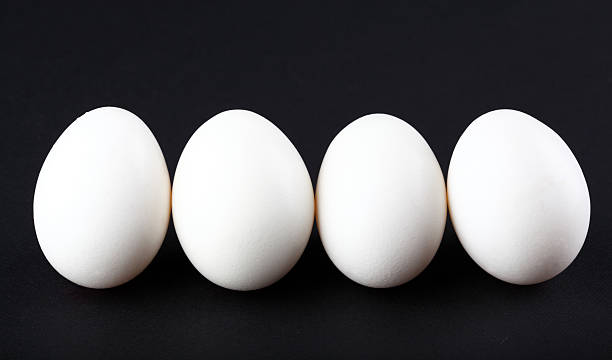Eggs isolated on black background stock photo
