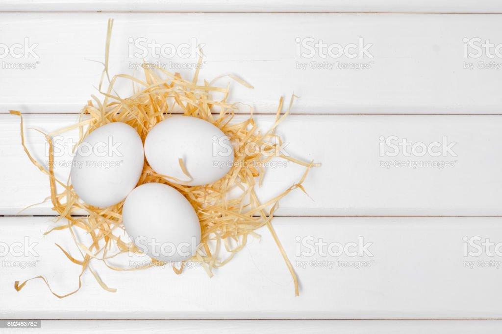 Eggs of white hay stock photo