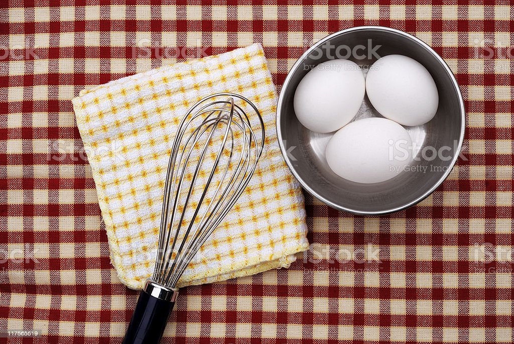 Eggs on checkered tablecloth royalty-free stock photo