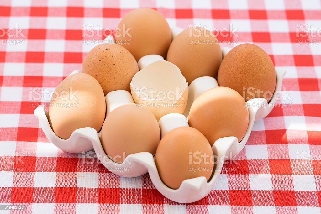 Eggs on red checkered tablecloth, Sun light royalty-free stock photo